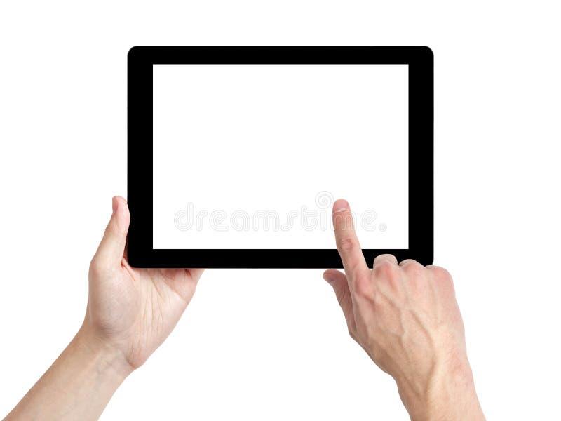 Manos adultas del hombre usando la PC de la tableta con la pantalla blanca fotografía de archivo libre de regalías
