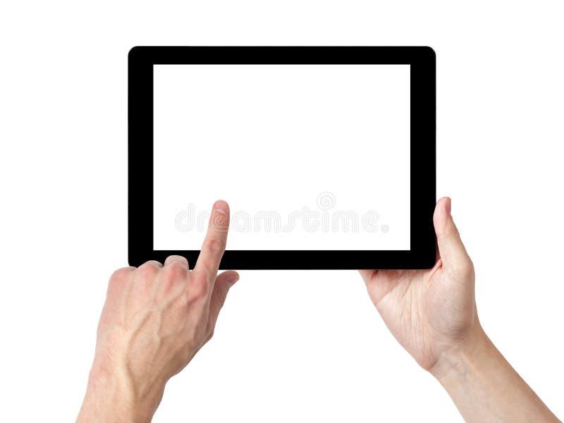 Manos adultas del hombre usando la PC de la tableta con la pantalla blanca fotografía de archivo