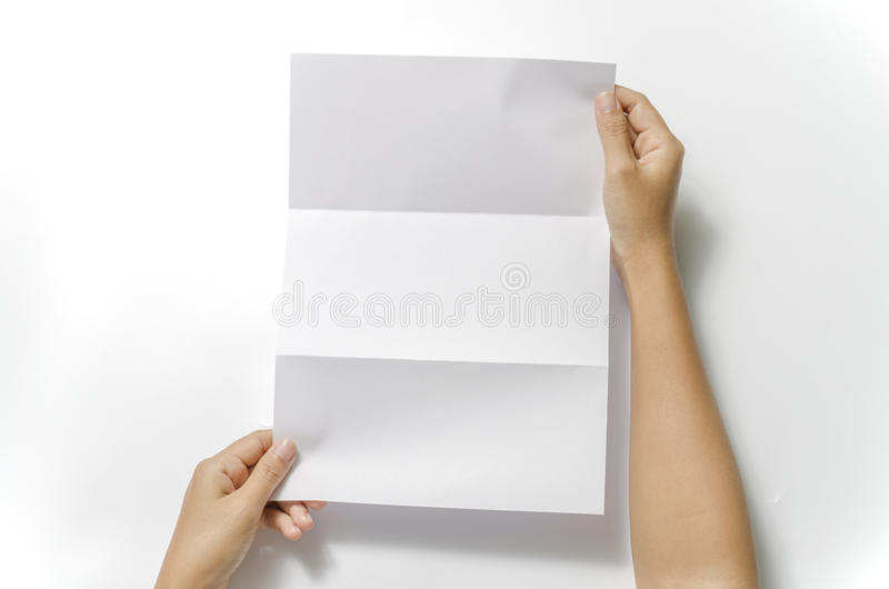 Manos de la mujer dos que sostienen el papel fotografía de archivo
