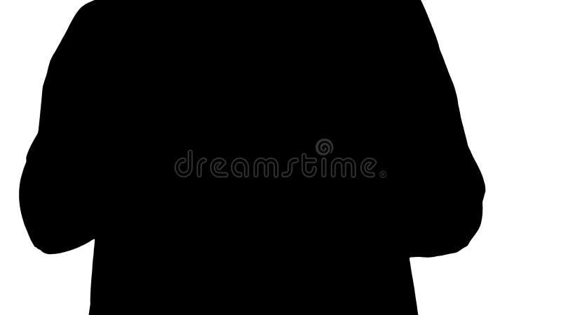 Manos de la silueta del hombre usando la tableta fotografía de archivo libre de regalías