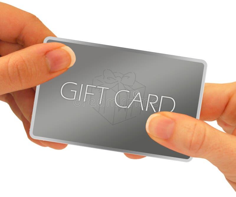 Manos de la tarjeta del regalo imagen de archivo libre de regalías