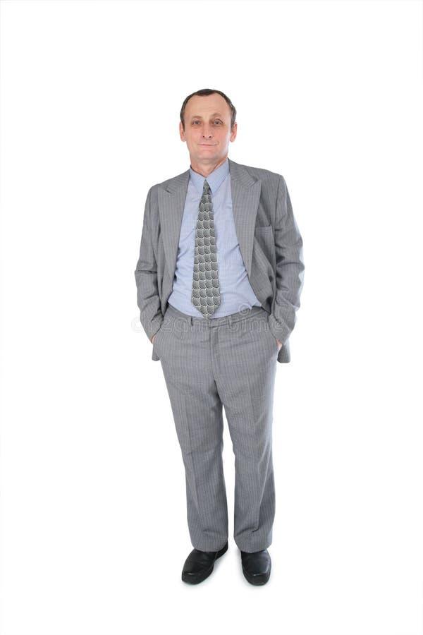 Manos del hombre de negocios en bolsillos imagenes de archivo