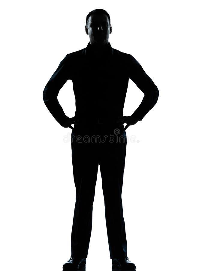 Manos derechas de un hombre de negocios en silueta de las caderas fotografía de archivo libre de regalías