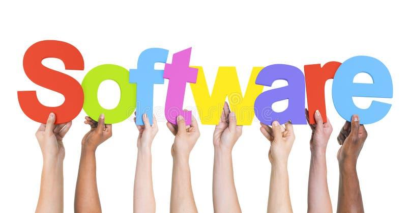 Manos diversas que llevan a cabo el software de la palabra imágenes de archivo libres de regalías