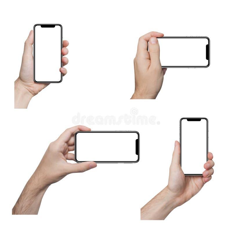 Manos masculinas aisladas que sostienen el teléfono imagen de archivo libre de regalías