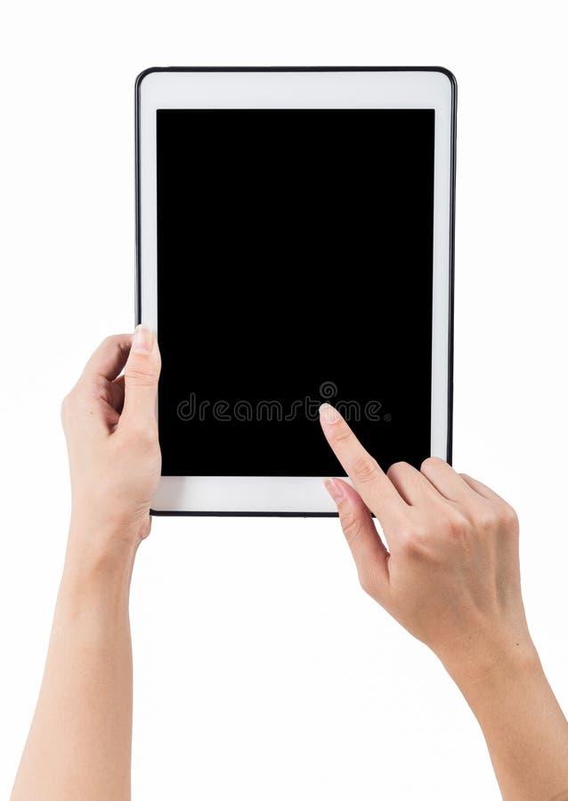 Manos que llevan a cabo el fondo blanco vertical de la tableta utilice la palmadita del recortes imagen de archivo libre de regalías