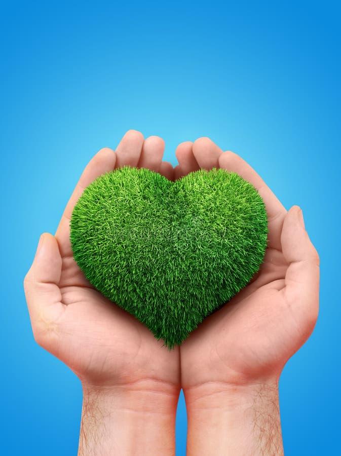 Manos que llevan a cabo un símbolo del corazón stock de ilustración