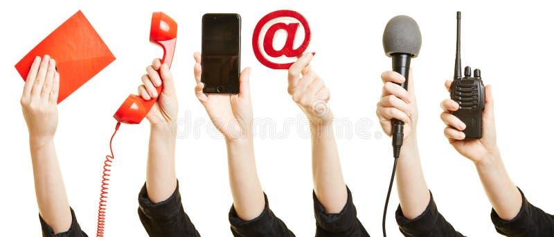 Manos que muestran maneras de comunicación foto de archivo libre de regalías