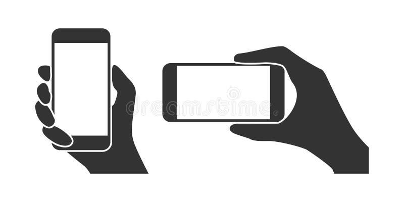 Manos que sostienen un teléfono ilustración del vector