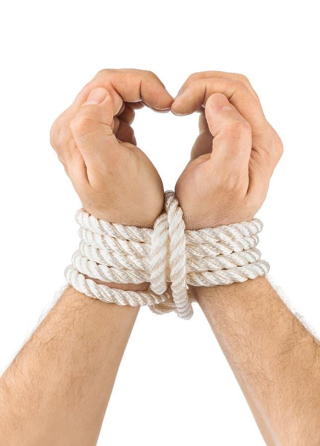 Manos y corazón encuadernados fotos de archivo libres de regalías