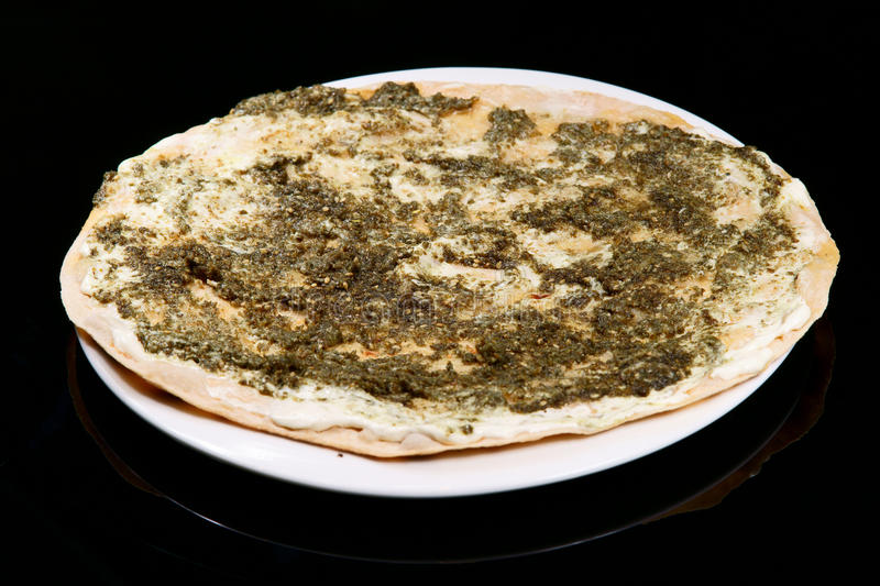 Manouche thyme and labneh. Manouche, Lebanese style thyme and labneh pizza on saj bread royalty free stock photo