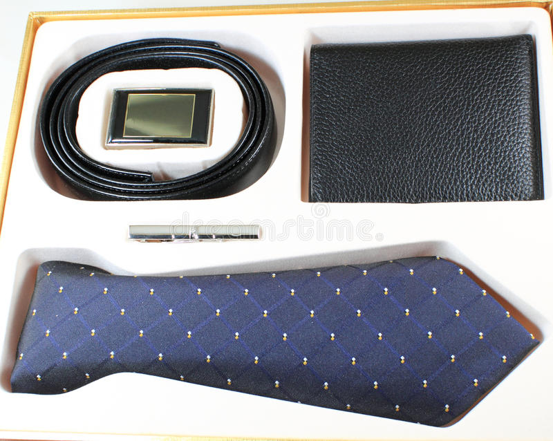 Men Accessories. Including tie, pin, belt, and purse, gift for holiday, big event or celebration royalty free stock image