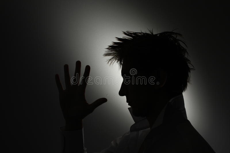 Mans Face Silhouette With Hand. Stock Photos