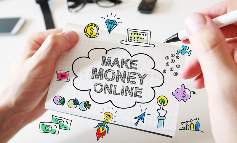 Mans hand drawing Make Money Online concept on notebook stock photo