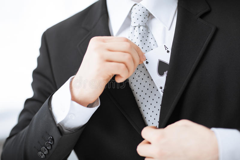 Mans Hand Hiding Ace In The Jacket Pocket Royalty Free Stock Images