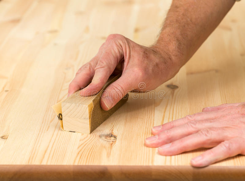 Download Mans Hand On Sanding Block On Pine Wood Stock Photo   Image Of  Furniture,
