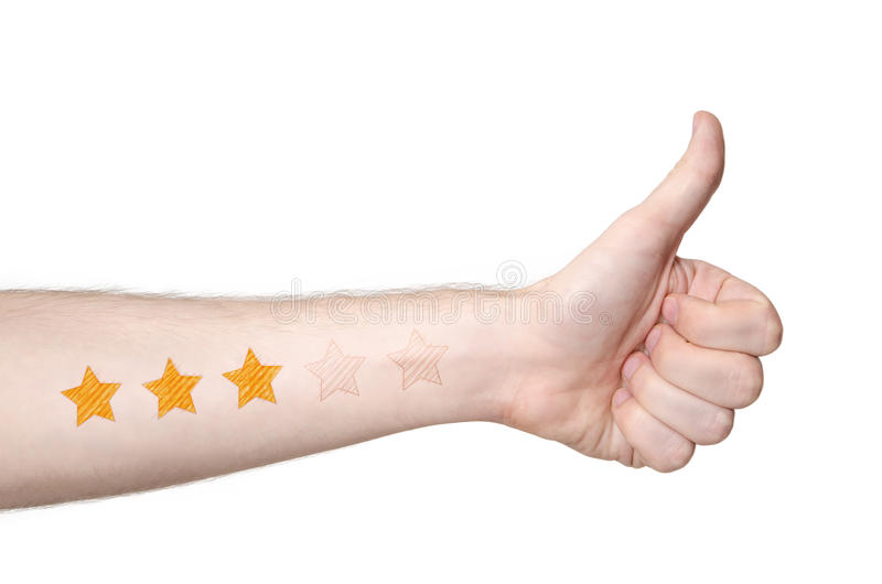 Mans hand thmbs up, and 3 star rating stock photography