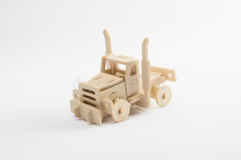 Mans hands assembling wooden track toy stock photos