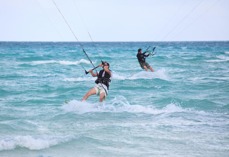 Download Mans riding his kiteboard. stock photo. Image of adult - 22828658