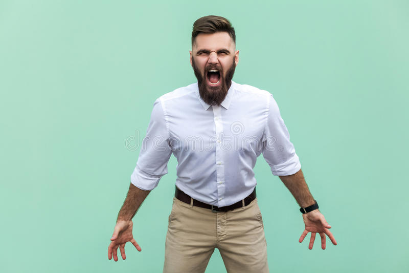 Mans roar! The angry businessman, screaming with closed eyes. Indoor, studio shot. royalty free stock image