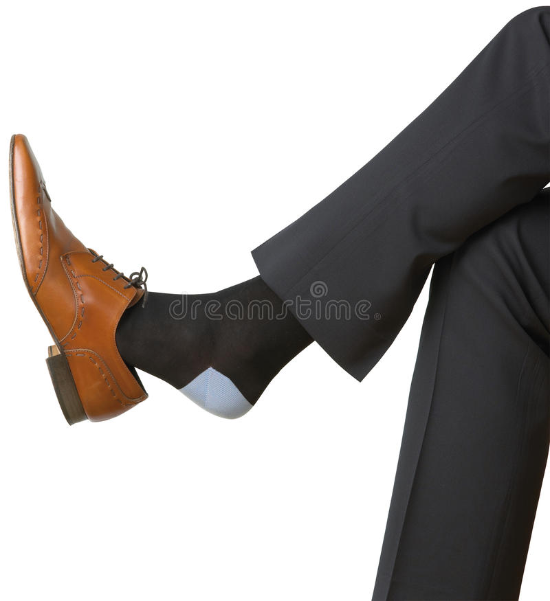 Mans shoe and foot on white background. A mans shoe and foot on white background stock photography