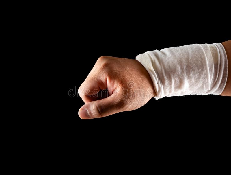 Mans wrapped hand on black royalty free stock image