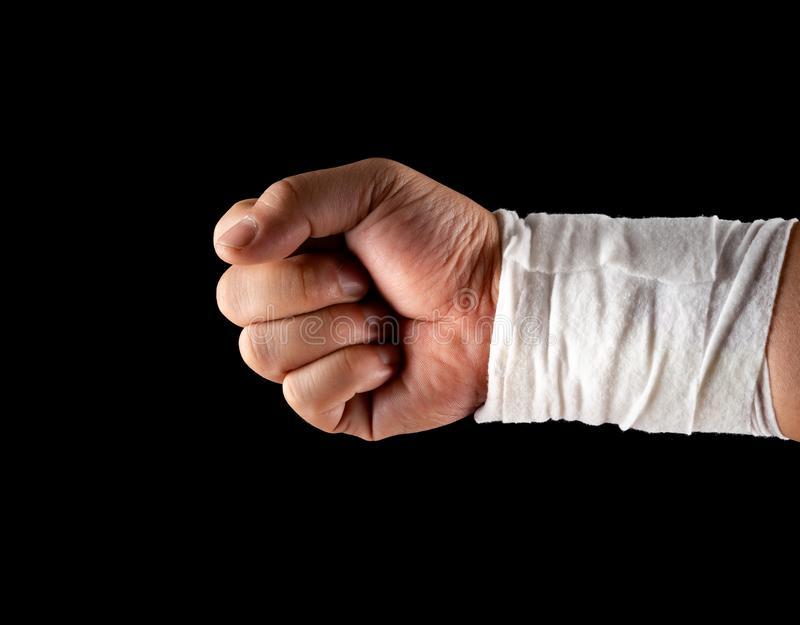 Mans wrapped hand on black royalty free stock images