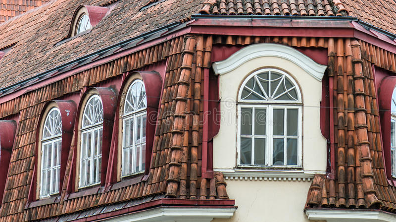 Mansard windows on a tile roof of the house in Tallinn stock image