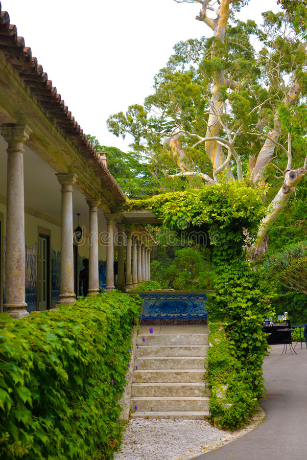 Country House Entrance, Mansion Balcony, Gardens Stairs, Luxury Estate, Marble Columns. Old luxurious country house balcony. Hand painted blue and white tiles on royalty free stock photography