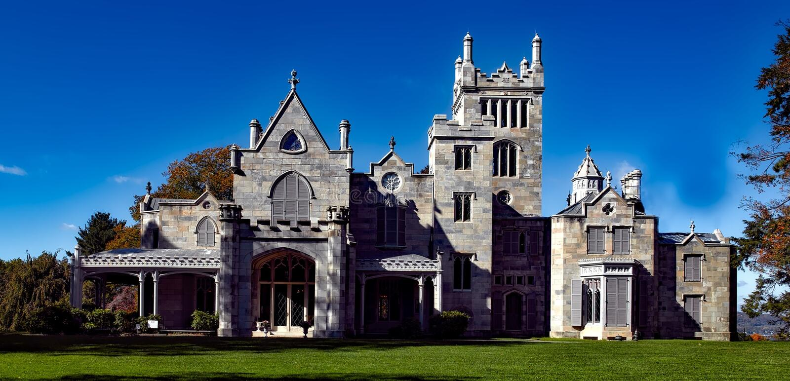 Mansion on green lawn, New York stock photo