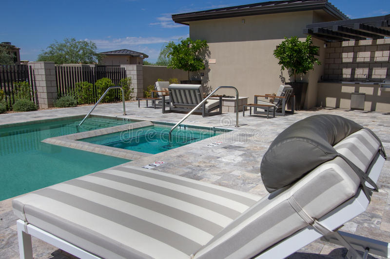 Mansion home outdoor plaza patio and pool. Outdoor patio of an Arizona Italian mansion with huge backyard pool royalty free stock photo