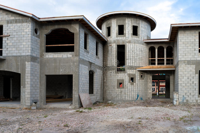 Mansion home under construction stock photo image of for Concrete block construction homes