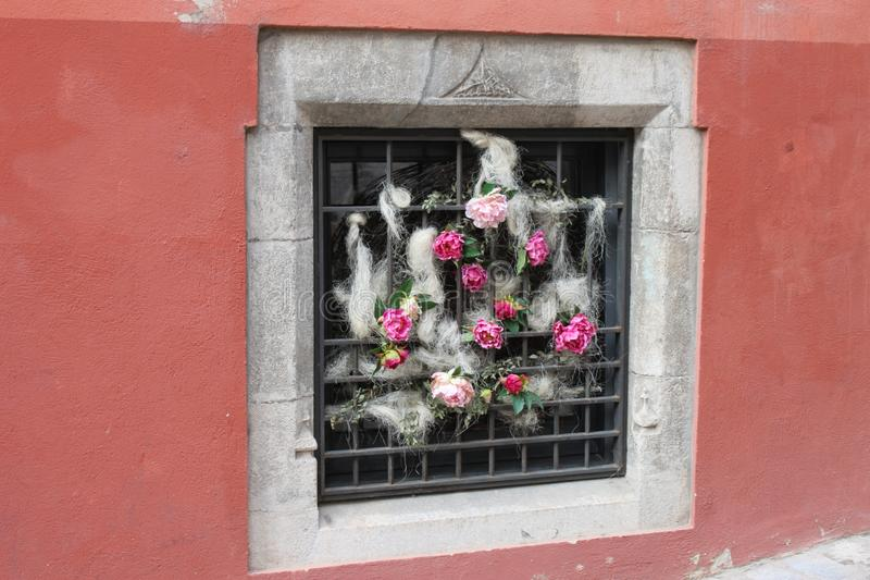 Mansion window adorned with flowers stock photos