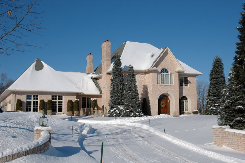 Mansion in winter stock images
