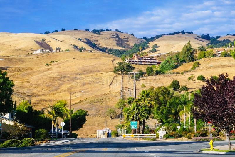 Mansions built on golden hills covered in dry grass, beautiful evening light; south San Jose, San Francisco bay area, California royalty free stock images