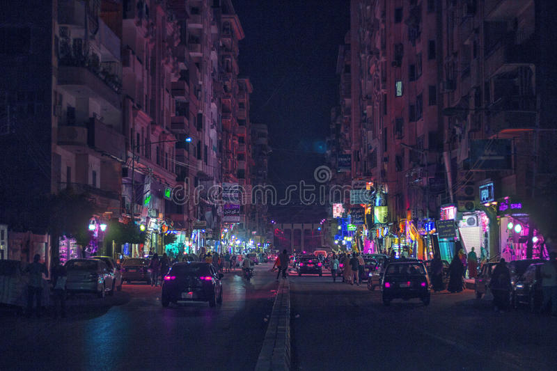 Mansoura city & x28; Gala& x27; st & x29;. A shot of a cars in the Gala& x27; st in Mansoura city with a cool lights in Eid and shops on the left and right sides stock photo