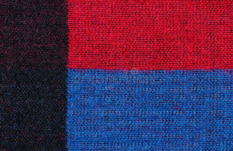 Manta de lana azul y negra roja imágenes de archivo libres de regalías
