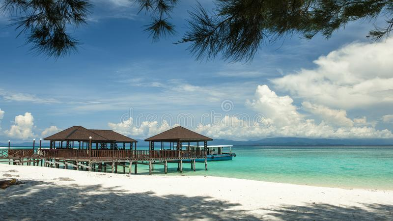Sabah Mermaid Island. Mantanani Island is nicknamed Mermaid Island. It is a 30-minute ferry ride from Kota Kinabalu. It consists of three outlying islands. It is stock photography