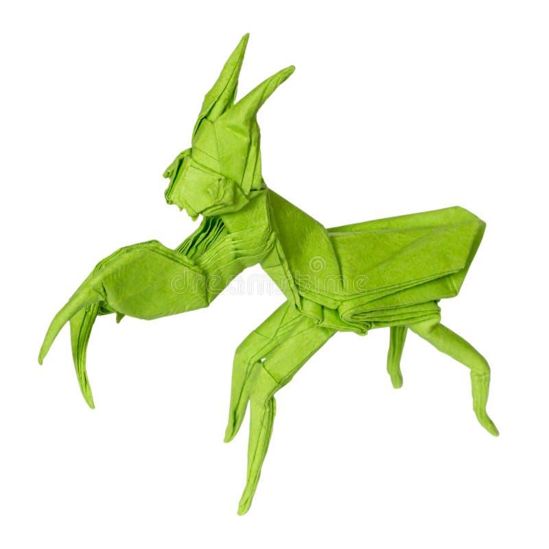 MANTE de prière d'origami pliée avec la feuille de Livre vert photographie stock libre de droits