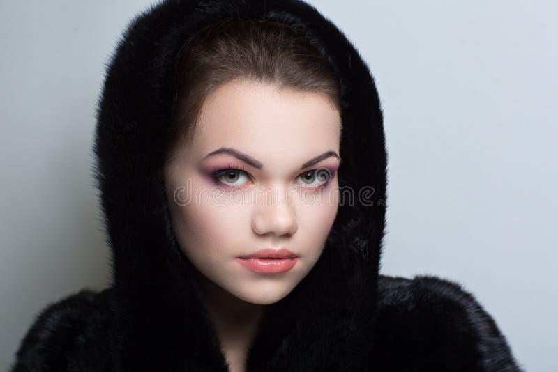 Manteau de fourrure noir images libres de droits