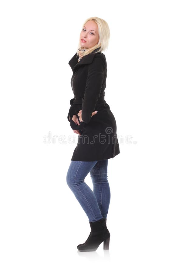 Manteau et jeans de fille photographie stock