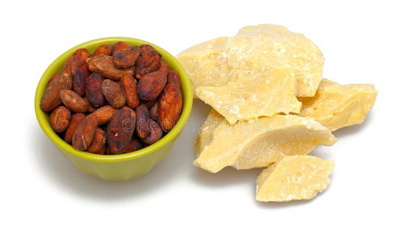 Manteca y habas de cacao imágenes de archivo libres de regalías