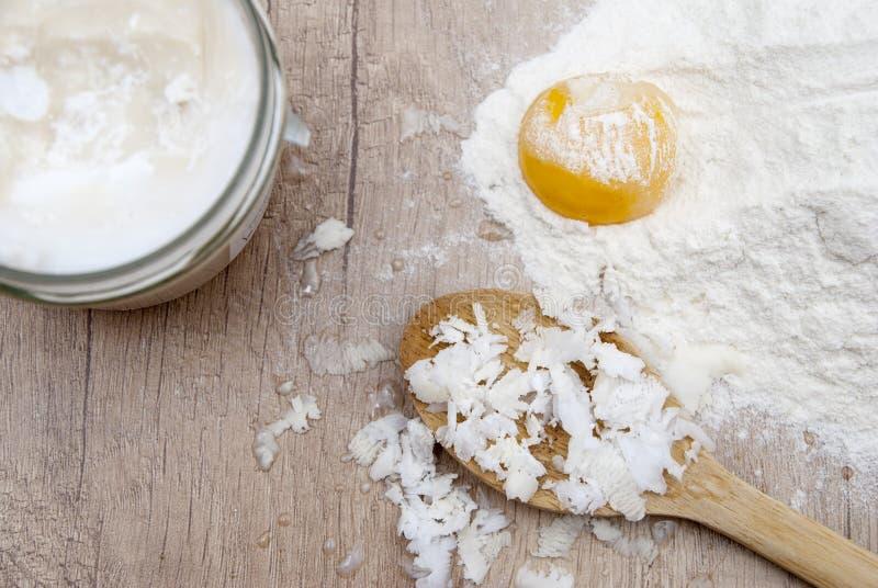 Manteiga, farinha e ovo de coco fotografia de stock