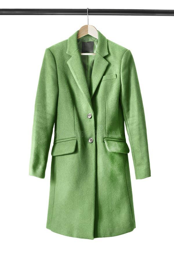 Mantel auf Kleiderständer stockfotos