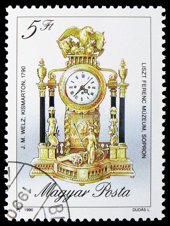 Mantel clock, 1790, Antique Clocks serie, circa 1990. MOSCOW, RUSSIA - JULY 19, 2019: Postage stamp printed in Hungary shows Mantel clock, 1790, Antique Clocks royalty free stock photos