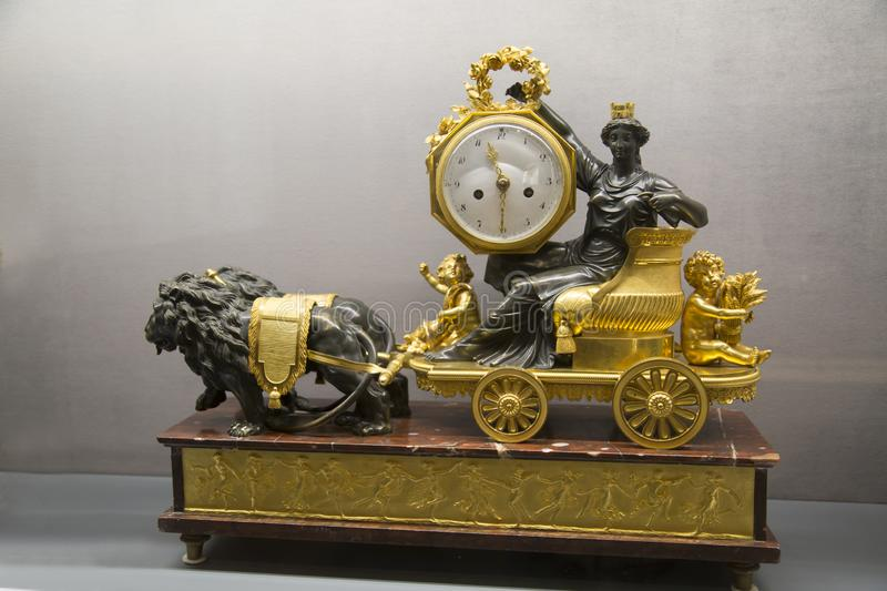 Mantel clock the eighteenth century Chariot of the Greek goddess Lions. Items old technology. stock photos