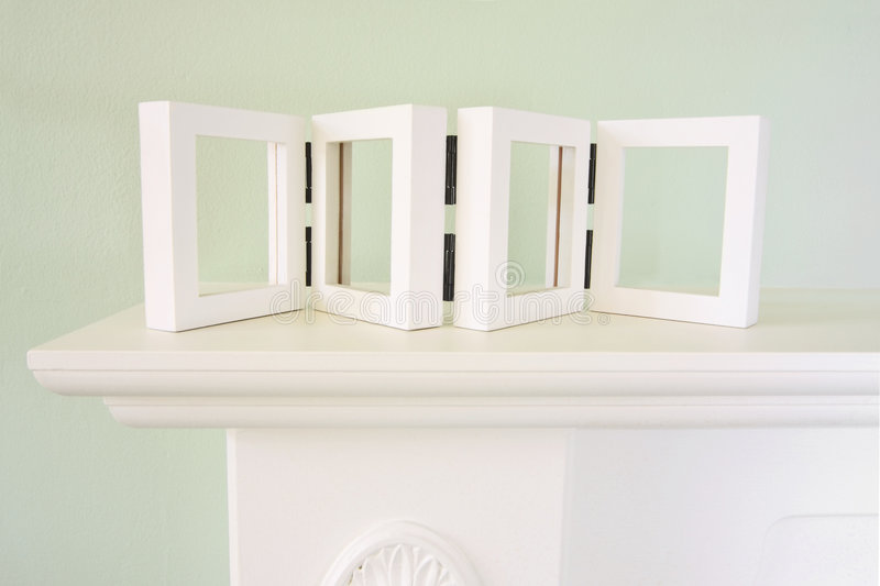 Mantel with em. Pty picture frame for your pictures stock photo