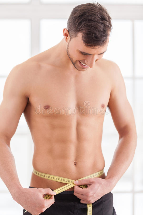 Mantendo o corpo na forma perfeita. imagem de stock