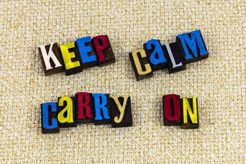 Mantenha calmo para continuar continuam a tipografia foto de stock royalty free