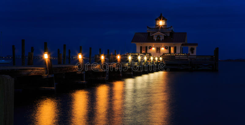 Manteo Marshes Light Lighthouse at night blue hour. Manteo NC Lighthouse right after sundown with lights on. Marshe's Light, located on the dock of Manteo NC royalty free stock photo
